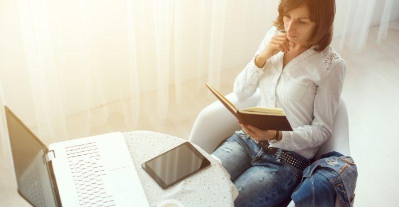 Woman Writing in Sleep Diary